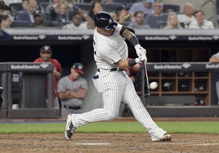 New York Yankees' Gleyber Torres hits a home run during the fifth inning of a baseball game against the Washington Nationals on Wednesday, June 13, 2018, at Yankee Stadium in New York. (AP Photo/Bill Kostroun)
