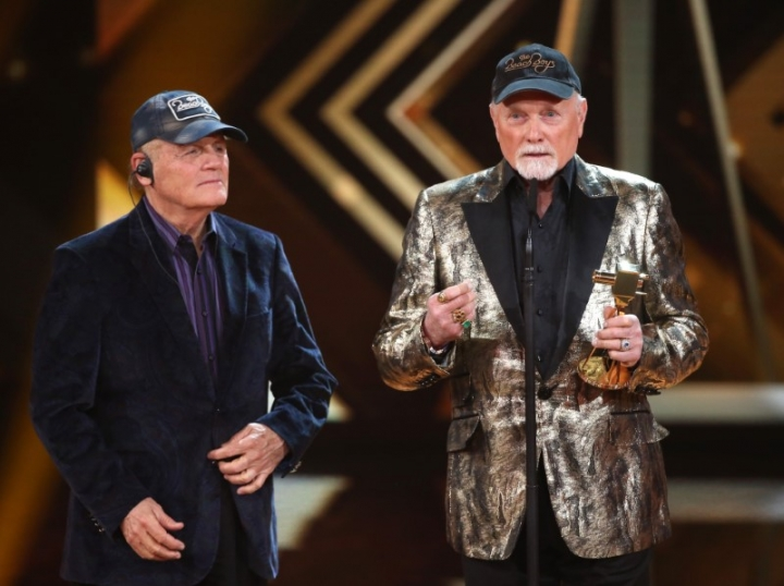 FILE PHOTO: Bruce Johnston (L) and Mike Love of the band The Beach Boys accept the award for Lifeswork Music during 'Die Goldene Kamera' (Golden Camera) awards ceremony in Hamburg, February 6, 2016.  REUTERS/Christian Charisius/Pool