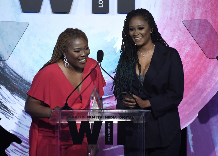 "Denisea ""Blu June"" Andrews, left, and Brittany Chi Coney accept the artistic excellence award at the Women In Film Crystal and Lucy Awards at the Beverly Hilton Hotel on Wednesday, June 13, 2018, in Beverly Hills, Calif. (Photo by Chris Pizzello/Invision/AP)"