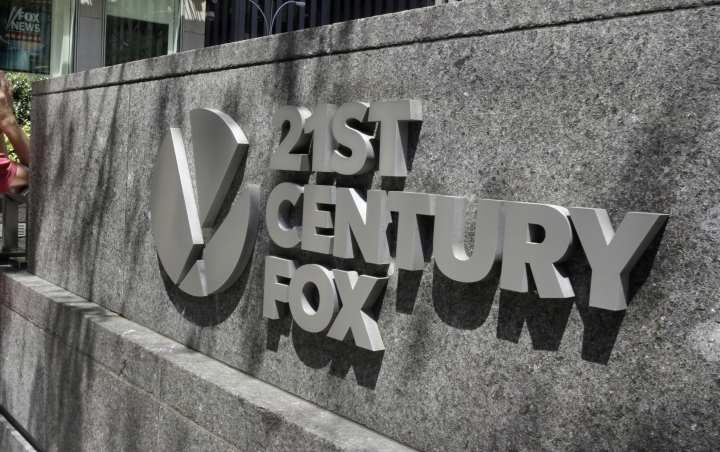FILE - This Aug. 1, 2017, file photo shows the Twenty-First Century Fox sign outside of the News Corporation headquarters building in New York. The potential for another media megadeal are sending shares of Comcast, Twenty-First Century Fox and Disney into motion before the opening bell. After a judge cleared AT&T's $85 billion takeover of Time Warner on Tuesday, June 12, 2018, many now expect Comcast to top Disney's pending $52.4 billion stock offer for the entertainment assets of Twenty-First Century Fox, possibly as early as Wednesday. (AP Photo/Richard Drew, File)