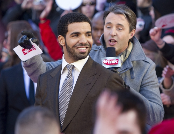 """FILE - In this March 27, 2011 file photo, Drake arrives on the red carpet at the 2011 JUNO Awards, Canada's music awards in Toronto. Drake is having a Degrassi Community School reunion. The rapper played Jimmy Brooks in the Canadian teen drama and a video released Wednesday, June 13, 2018, for his single """"I'm Upset"""" features several of his """"Degrassi: The Next Generation"""" cast mates. (Darren Calabrese/The Canadian Press via AP)"""