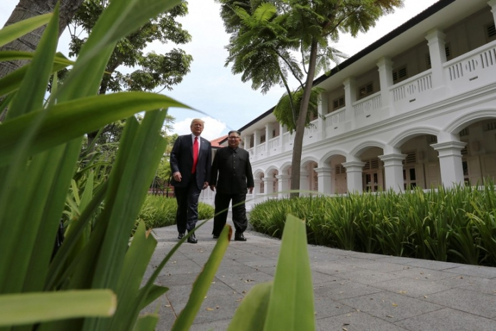 FILE PHOTO: U.S. President Donald Trump and North Korea's leader Kim Jong Un walk together before their working lunch during their summit at the Capella Hotel on the resort island of Sentosa, Singapore June 12, 2018. REUTERS/Jonathan Ernst/File Photo