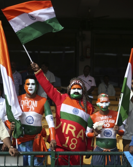 Indian cricket fans cheer for their team before the start of the one-off cricket test match between India and Afghanistan in Bangalore, India, Thursday, June 14, 2018. (AP Photo/Aijaz Rahi)
