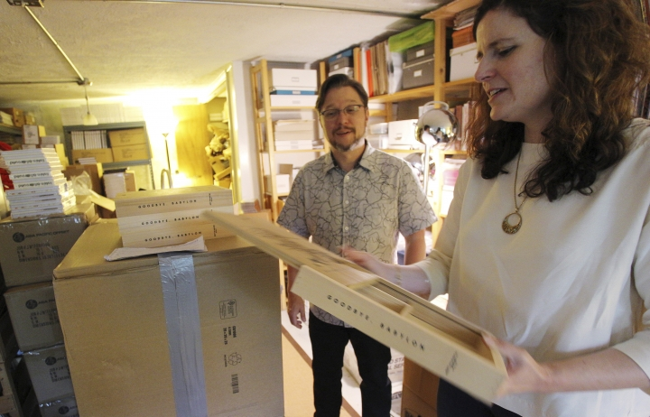 """In this Tuesday, May 29, 2018 photo, April Ledbetter holds a copy of """"Goodbye, Babylon,"""" a box set of recordings released by Dust-To-Digital, in the basement of her Atlanta home. Ledbetter and her husband Lance Ledbetter operate Dust-to-Digital, a record label that digitizes and re-releases old recordings. (AP Photo/Ron Harris)"""