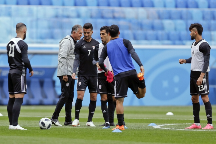 Iran head coach Carlos Queiroz walks among his player during the official training of Iran on the eve of the group B match between Morocco and Iran at the 2018 soccer World Cup in the St. Petersburg Stadium in St. Petersburg, Russia, Thursday, June 14, 2018. (AP Photo/Andrew Medichini)