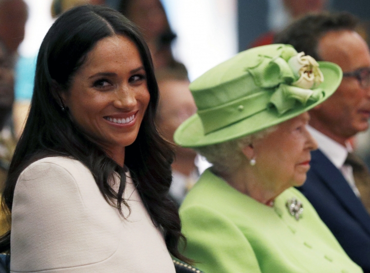 Britain's Queen Elizabeth and Meghan, Duchess of Sussex visit the Storyhouse Chester, in Chester, England, Thursday, June 14, 2018. (Phil Noble/Pool Photo via AP)