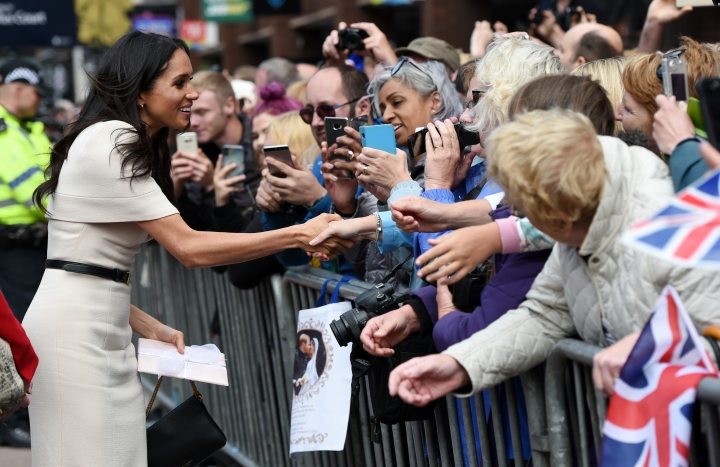 Meghan, Duchess of Sussex is greeted by crowds of people during a visit with Britain's Queen Elizabeth II to Chester, north west England, Thursday, June 14, 2018. (Eddie Mulholland/Pool Photo via AP)