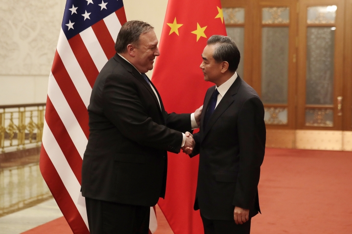 U.S. Secretary of State Mike Pompeo, left, shakes hands with Chinese Foreign Minister Wang Yi before their meeting at the Great Hall of the People in Beijing, Thursday, June 14, 2018. (AP Photo/Andy Wong, Pool)