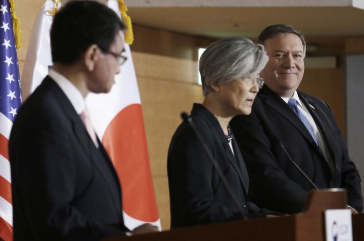 U.S. Secretary of State Mike Pompeo, right, and Japanese Foreign Minister Taro Kono, left, listen to South Korean Foreign Minister Kang Kyung-wha during a joint press conference following their meeting at Foreign Ministry in Seoul, South Korea, Thursday, June 14, 2018. (AP Photo/Ahn Young-joon)