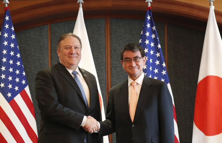 U.S. Secretary of State Mike Pompeo, left, poses with Japanese Foreign Minister Taro Kono for a photo during a bilateral meeting at a hotel in Seoul, South Korea, Tuesday, June 14, 2018. (im Hong-ji/Pool Photo via AP)