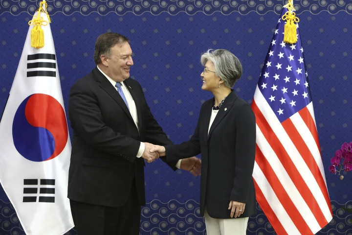 U.S. Secretary of State Mike Pompeo, left, shakes hands with South Korean Foreign Minister Kang Kyung-wha during their meeting at Foreign Ministry in Seoul, South Korea, Thursday, June 14, 2018. (Chung Sung-Jun/Pool Photo via AP)