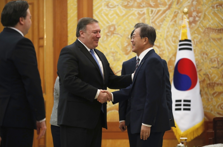 U.S. Secretary of State Mike Pompeo, second from left, shakes hands with South Korean President Moon Jae-in during a bilateral meeting at the presidential Blue House in Seoul, South Korea Thursday, June 14, 2018. (Kim Hong-ji/Pool Photo via AP)