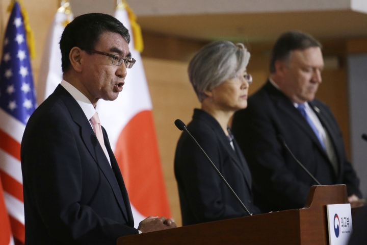Japanese Foreign Minister Taro Kono, left, speaks as U.S. Secretary of State Mike Pompeo, right, and South Korean Foreign Minister Kang Kyung-wha listen during a joint press conference following their meeting at Foreign Ministry in Seoul, South Korea, Thursday, June 14, 2018. (AP Photo/Ahn Young-joon)