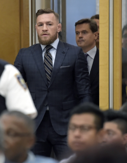 Mixed martial arts fighter Conor McGregor arrives at Brooklyn Supreme Court, Thursday, June 14, 2018, in New York. McGregor expressed regret on Thursday for a backstage melee at a Brooklyn arena, and is in plea negotiations to resolve charges in the case. (Rashid Umar Abbasi /New York Post via AP, Pool)