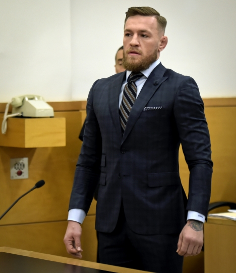 Mixed martial arts fighter Conor McGregor appears at Brooklyn Supreme Court, Thursday, June 14, 2018, in New York. McGregor expressed regret on Thursday for a backstage melee at a Brooklyn arena, and is in plea negotiations to resolve charges in the case. (Rashid Umar Abbasi /New York Post via AP, Pool)