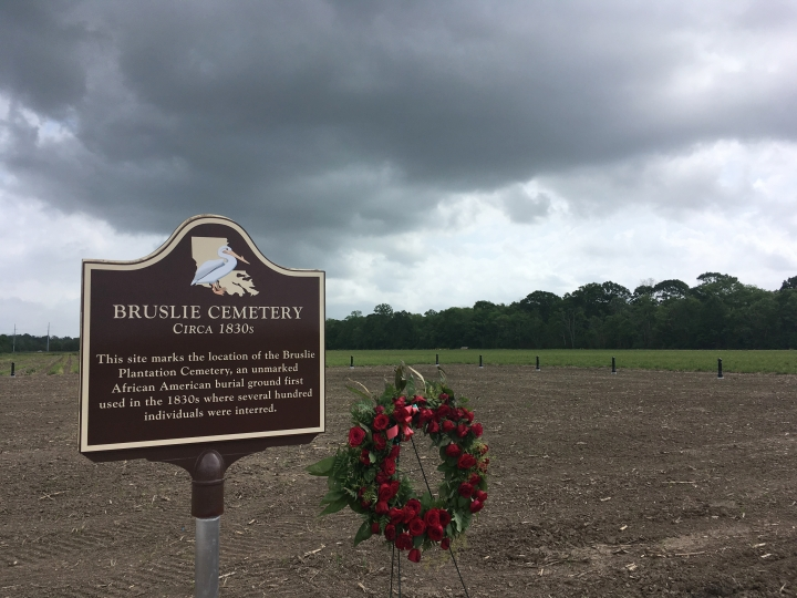 In this taken March 28., 2018 photo, shows the Bruslie Cemetery, a burial ground for slaves in New Orleans. The Shell Oil Company has spruced up, marked and blocked off tracts of its land in the Convent community west of New Orleans where archaeologists confirmed the presence of slave burial grounds in 2013. (AP Photo/Kevin McGill)