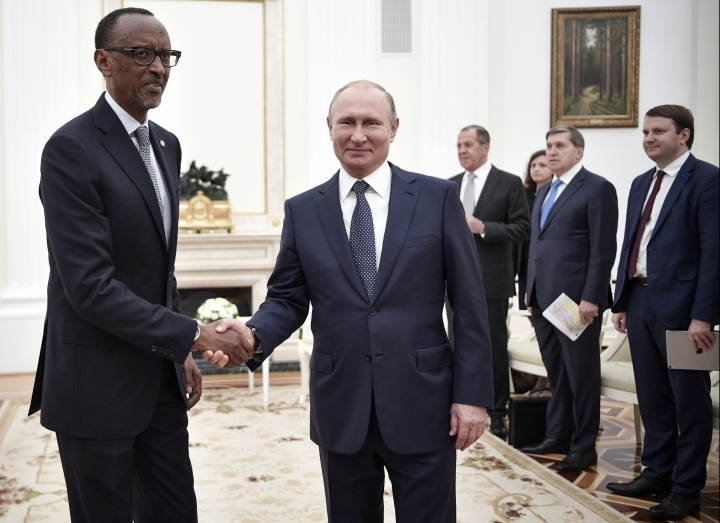 Russian President Vladimir Putin, center, and Rwanda's President Paul Kagame, left, shake hands while posing for a photo prior to their talks in Moscow, Russia, Wednesday, June 13, 2018. (Alexei Nikolsky, Sputnik, Kremlin Pool Photo via AP)