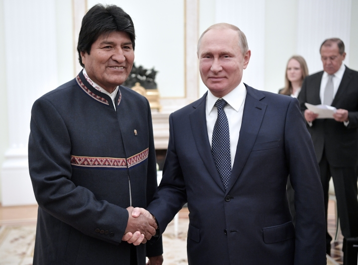 Russian President Vladimir Putin, right, shakes hands with Bolivia's President Evo Morales prior to their talks in Moscow, Russia, Wednesday, June 13, 2018. (Alexei Nikolsky, Sputnik, Kremlin Pool Photo via AP)