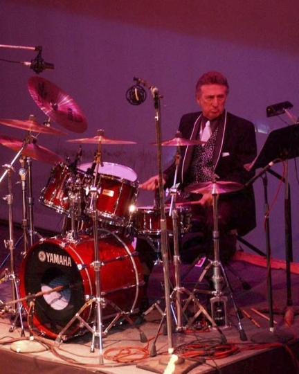 FILE- In this Oct. 16, 2004 file photo, longtime Elvis Presley drummer D.J. Fontana performs at the 50th anniversary celebration concert of Elvis Presley's first performance at the Louisiana Hayride in Sherveport, La. Fontana, the drummer who helped launch rock 'n' roll as Elvis Presley's sideman, has died at 87, his wife said Thursday, June 14, 2018. Karen Fontana told The Associated Press that her husband died Wednesday, June 13 in his sleep in Nashville. (Robert Ruiz/The Shreveport Times via AP)