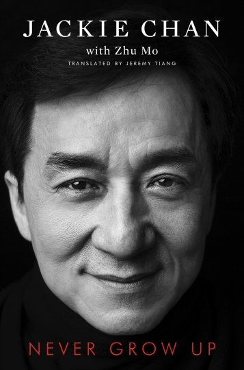 "This cover image released by Gallery Books shows ""Never Grow Up,"" a memoir by Jackie Chan, which will be released in November. (Gallery Books via AP)"