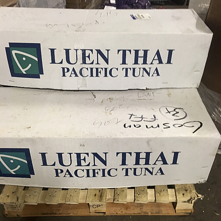 Boxes containing imported headless tuna sit on a pallet on Thursday, July 6, 2017, marked to be picked up by a driver from the Bob Gosman Co., at the New Fulton Fish Market in New York. Bob Gosman Co., a supplier for Sea to Table, gets some of its fish from Fulton, a place in the state where many fish can always be found, regardless of the season. (AP Photo/Robin McDowell)