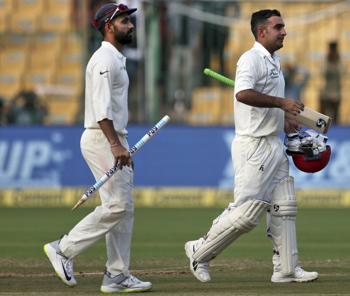 Afghanistan's Hashmatullah Shahidi, right, and Indian captain Ajinkya Rahane leave the ground after Indian won the one-off cricket test match in Bangalore, India, Friday, June 15, 2018. (AP Photo/Aijaz Rahi)