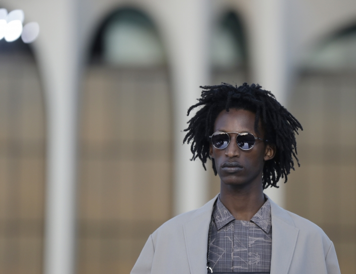 A model wears a creation part of the Ermenegildo Zegna men's Spring-Summer 2019 collection, that was presented in Milan, Italy, Friday, June 15, 2018. (AP Photo/Luca Bruno)