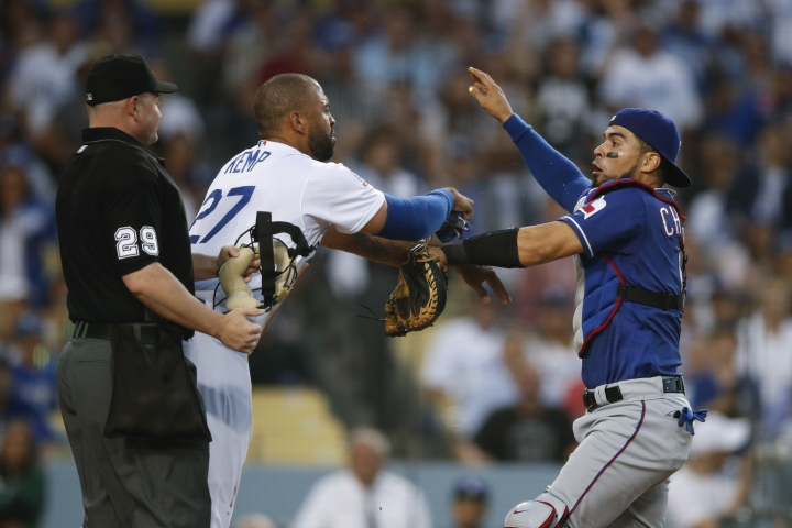 Los Angeles Dodgers' Matt Kemp, left, and Texas Rangers catcher Robinson Chirinos scuffle after Chirinos was shoved by Kemp at home plate during the third inning of a baseball game, Wednesday, June 13, 2018, in Los Angeles. (AP Photo/Jae C. Hong)