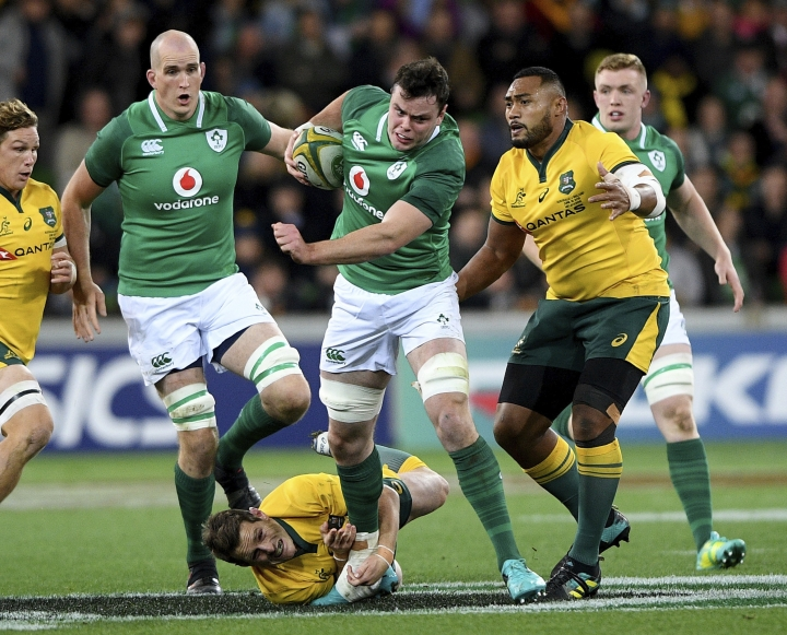 Ireland's James Ryan, center, attacks during the international rugby match against Australia in Melbourne, Australia, Saturday, June 16, 2018. (AP Photo/Andy Brownbill)