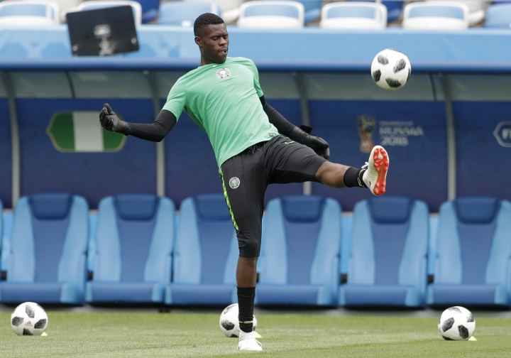 Nigeria goalkeeper Francis Uzoho kicks the ball during Nigeria's official training on the eve of the group D match between Croatia and Nigeria at the 2018 soccer World Cup in the Kaliningrad Stadium in Kaliningrad, Russia, Friday, June 15, 2018. (AP Photo/Petr David Josek)