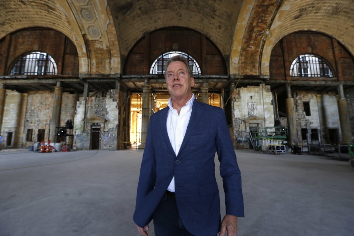 In this Thursday, June 14, 2018 photo, Bill Ford Jr., Ford Motor Company Executive Chairman and Chairman of the Board, poses in the Michigan Central Station in Detroit. Ford Motor Co. is embarking on a 4-year renovation of the 105-year-old depot and 17-story office tower just west of downtown. The massive project is expected to increase the automaker's footprint in the city where the company was founded, provide space for electric and autonomous vehicle testing and research and spur investment in the surrounding neighborhood. (AP Photo/Paul Sancya)