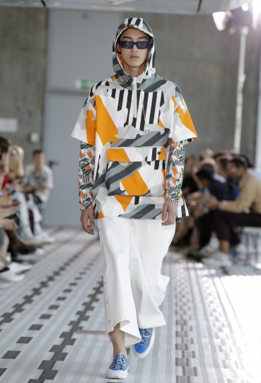 A model wears a creation part of the Sunnei men's Spring-Summer 2019 collection, that was presented in Milan, Italy, Sunday, June 17, 2018. (AP Photo/Luca Bruno)