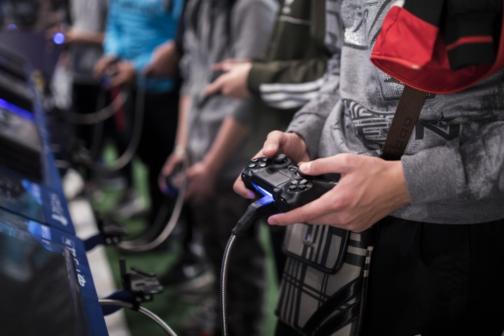 FILE - In this Friday, Nov. 3, 2017 file photo, a man plays a game at the Paris Games Week in Paris. The World Health Organization says that compulsively playing video games now qualifies as a new mental health condition, in a move that some critics warn may risk stigmatizing its young players. (AP Photo/Kamil Zihnioglu, File)