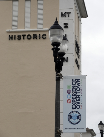 In this Monday, May 21, 2018 photo, a banner hangs in front of the Mount Zion Baptist church in the Overtown neighborhood of Miami. Celebrity chef Marcus Samuelsson has purchased a former pool hall in the neighborhood and plans to open a restaurant there. The redevelopment board is pouring tens of millions into restoring the historic neighborhood to its former glory. (AP Photo/Lynne Sladky)