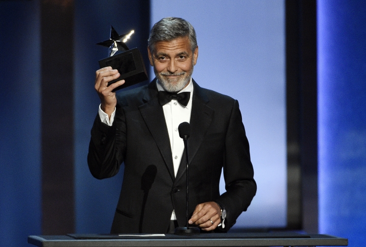 FILE - In this June 7, 2018 file photo, actor/director George Clooney accepts the 46th AFI Life Achievement Award during a gala ceremony in Los Angeles. The ceremony will air on Thursday, June 21. (Photo by Chris Pizzello/Invision/AP, File)