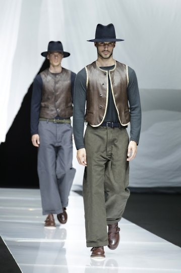 Models wear creations as part of the Armani men's 2019 Spring-Summer collection, unveiled during the Fashion Week in Milan, Italy, Monday, June 18, 2018. (AP Photo/Luca Bruno)