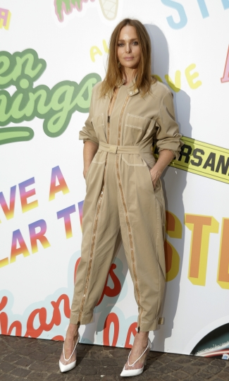 Stella McCartney arrives to present her men's Spring-Summer 2019 collection, that was presented in Milan, Italy, Monday, June 18, 2018. (AP Photo/Luca Bruno)