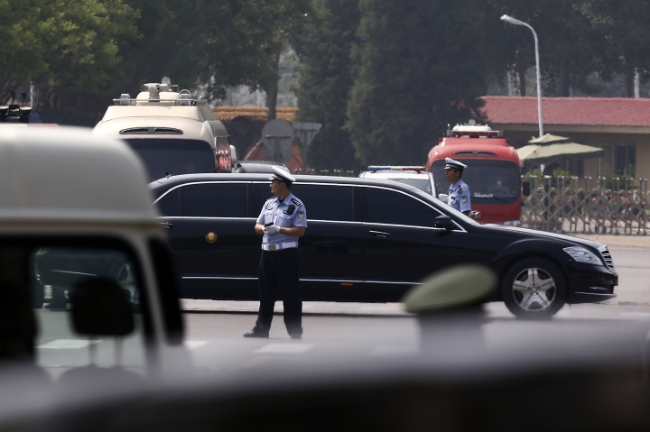 The motorcade which is believed to be carrying North Korea leader Kim Jong Un passes by policemen as it leaves the Beijing Capital International Airport in Beijing, Tuesday, June 19, 2018. Chinese state media say North Korean leader Kim Jong Un will make a two-day state visit starting Tuesday. (AP Photo/Andy Wong)