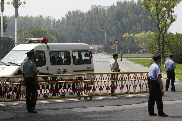 Paramilitary policemen and policemen seal off a road near the main entrance gate of the VIP gate of Beijing Capital International Airport as they preparing for the arrival of the North Korean leader Kim Jong Un, in Beijing, Tuesday, June 19, 2018. Chinese state media say North Korean leader Kim Jong Un will make a two-day visit to Beijing starting Tuesday following his groundbreaking summit with President Donald Trump in Singapore last week. (AP Photo/Andy Wong)