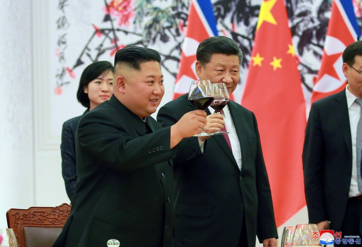 """In this June 19, 2018, photo provided on June 20, 2018, by the North Korean government, North Korean leader Kim Jong Un, left, toasts with Chinese President Xi Jinping, at the Great Hall of the People in Beijing, China. Korean language watermark on image as provided by source reads: """"KCNA"""" which is the abbreviation for Korean Central News Agency. (Korean Central News Agency/Korea News Service via AP)"""