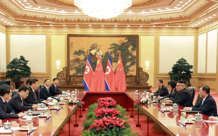 In this June 19, 2018, photo provided on June 20, 2018, by the North Korean government, Chinese President Xi Jinping, third from left, and North Korean leader Kim Jong Un, second from right, hold a talk at the Great Hall of the People in Beijing, China. (Korean Central News Agency/Korea News Service via AP)