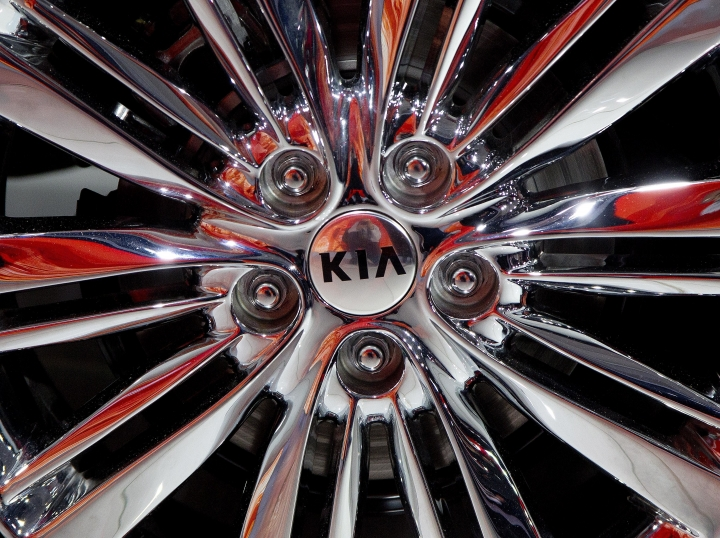 FILE - This April 1, 2015, file photo shows a wheel of the 2016 Kia Optima on display at the New York International Auto Show. The annual survey by J.D. Power finds that buyers reported a record-low 93 problems per 100 vehicles during the first three months of ownership, four problems fewer than last year. The survey also found that Korean brands Genesis, Kia and Hyundai claimed the top three spots for the first time in new vehicle quality. (AP Photo/Mark Lennihan, File)