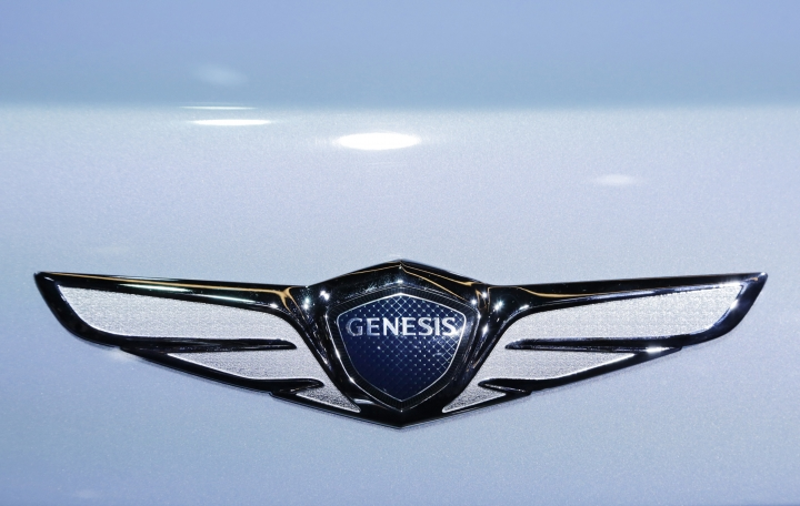 FILE- In this March 24, 2016, file photo, the emblem for the Genesis New York Concept is displayed at the New York International Auto Show. The annual survey by J.D. Power finds that buyers reported a record-low 93 problems per 100 vehicles during the first three months of ownership, four problems fewer than last year. The survey also found that Korean brands Genesis, Kia and Hyundai claimed the top three spots for the first time in new vehicle quality. (AP Photo/Mark Lennihan, File)