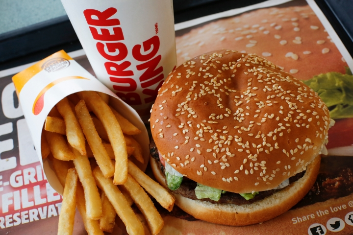 FILE- This Feb. 1, 2018, file photo shows a Burger King Whopper meal combo at a restaurant in the United States. Burger King says it's sorry for offering a lifetime supply of Whoppers to Russian women who get pregnant from World Cup players. (AP Photo/Gene J. Puskar, File)