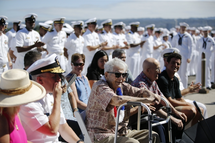 Pearl Harbor survivor Ray Emory, center, sits a surprise ceremony honoring him, Tuesday, June 19, 2018, in Honolulu. Emory, who served aboard the USS Honolulu during the 1941 attack, is moving back the the mainland and wanted to visit the site where his former ship was moored one last time. (AP Photo/Marco Garcia)