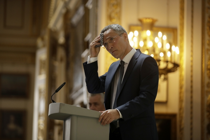 Jens Stoltenberg, the Secretary General of NATO, wipes sweat from his brow as he listens to a question after delivering a pre-NATO summit speech at Lancaster House in London, Thursday, June 21, 2018. The secretary-general of NATO says bonds between Europe and North America have weakened, and he appealed for an international effort to shore up the trans-Atlantic military alliance. (AP Photo/Matt Dunham)