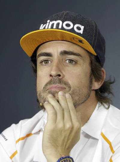 McLaren driver Fernando Alonso of Spain attends a news conference at the Paul Ricard racetrack, in Le Castellet, southern France, Thursday, June 21, 2018. The Formula one race will be held on Sunday. (AP Photo/Claude Paris)