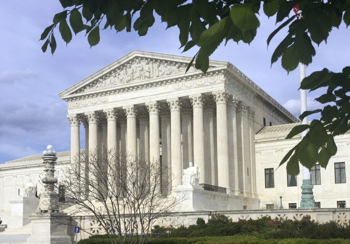 FILE - This April 23, 2018, file photo shows the Supreme Court in Washington. The Supreme Court says states can force online shoppers to pay sales tax. The 5-4 ruling Thursday is a win for states, who said they were losing out on billions of dollars annually under two decades-old Supreme Court decisions that impacted online sales tax collection. The high court ruled Thursday to overturn those decisions. (AP Photo/Jessica Gresko, File)