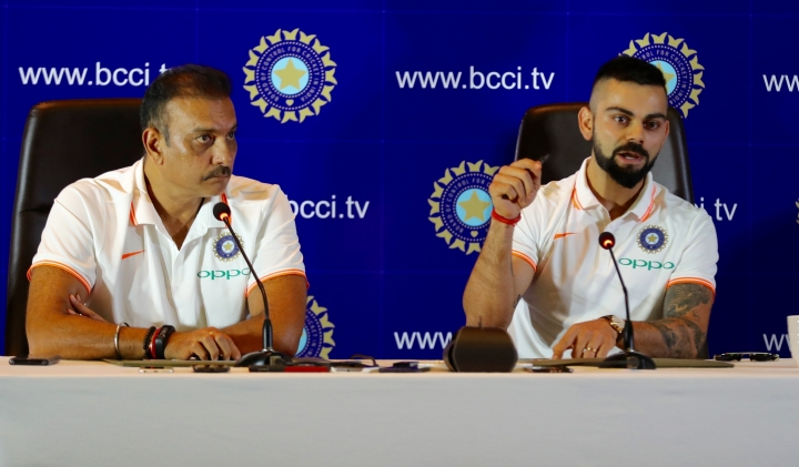 Indian cricket captain Virat Kohli, right and head coach Ravi Shastri address the media ahead of the team's travel to England and Ireland in New Delhi, India, Friday, June 22, 2018. (Manish Swarup)