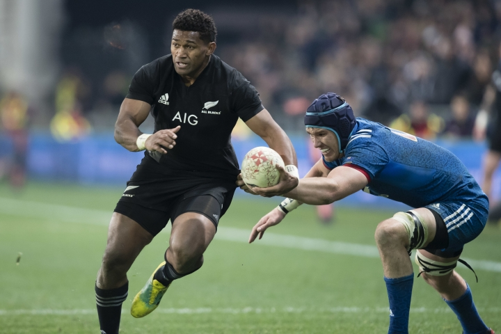 New Zealand's Waisake Naholo, left, beats France's Bernard le Roux in the rugby test in Dunedin, New Zealand, Saturday, June 23, 2018. (AP Photo/Adam Binns)